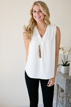 Simple Delight White V-Neck Sleeveless Blouse Our Simply Delight White V-Neck Sleeveless Blouse is a perfect professional look. This blouse will give you that tailored vibe, and you will be looking gr
