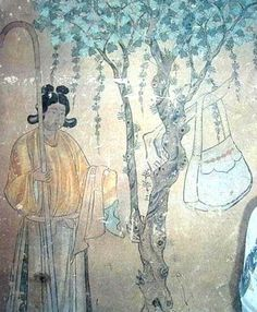 A maid from the Tang Dynasty (618-907) with a handbag is seen on a Dunhuang fresco
