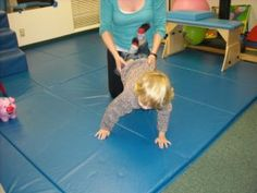 Weight bearing on arms for proprioceptive input - Creighton Pediatric Therapy