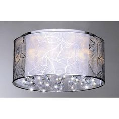 With an elegant, contemporary design on the polished chrome shade, this versatile flush mount crystal five-light chandelier brings a modern look to the dining room, bedroom, or entryway, while the sparkling crystal accents lend classic appeal.