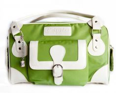 This bag is cute and stylish and roomy enough for my camera, cleaning kit, extra batteries, and my mini tripod!