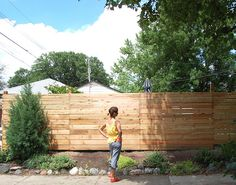 fence - horizontal pailings with two different size timber