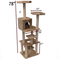 An amazing cat castle with multiple elevated viewing perches, a private residence and a hanging mouse toy and batting rope.