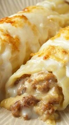 Sausage Cannelloni -- Ingredients : 1 pound Italian Sausage - if links, removed from casing 2 tablespoons olive oil 1 medium onion, finely chopped. Great Recipes, Dinner Recipes, Favorite Recipes, Beef Dishes, Food Dishes, Hamburger Dishes, Hamburger Casserole, Pork Recipes, Cooking Recipes