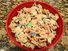 White Trash Recipe 1 c. M&Ms 1 1/2 c. corn chex cereal 2 c. pretzel sticks 1 c. cocktail peanuts 14 oz. white chocolate
