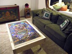 LED Pinball coffee table. I like the idea of getting good deals on non-working pinball machines to use like this. Very cool.