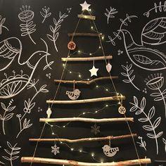 Blackboard wall decorated with twig Christmas tree