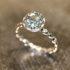 Floral Aquamarine Engagement Ring in 14k White Gold Diamond Pebble Ring 8x8mm Round Natural Aquamarine Ring (Bridal Set Available) by LaMoreDesign on Etsy https://www.etsy.com/listing/186367526/floral-aquamarine-engagement-ring-in-14k
