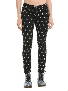 <div><div><i>I want your skulls</i></div><div><i>I need your skulls</i></div><div><i>I want your skulls</i></div><div><i>I need your skulls</i></div></div><div><br></div><div>These black skinny jeans from Tripp have an allover embroidered skull print. 5-pocket styling and button and zip fly.</div><di...