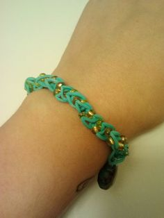 Check out this item in my Etsy shop https://www.etsy.com/listing/198147113/beaded-turquoise-rubber-band-bracelet