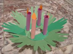 advent wreath #3 from Catholicmom.com    I love the idea of using the handprints for this.    http://happyhomefairy.com/2010/11/28/christmas-craft-advent-wreaths/