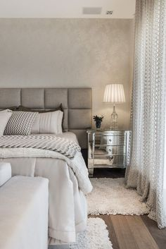 The #white, #offwhite and muted #greys in this room give a sense of softness and calmness, perfect for a relaxing #bedroom. #interior #design
