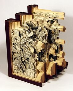 Books. If anyone knows the name of the artist let me know. I would love to give them credit.