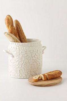 my life would grand if it required me to have this beautiful bread bin and to keep it stocked with freshly baked baguettes... everyday...