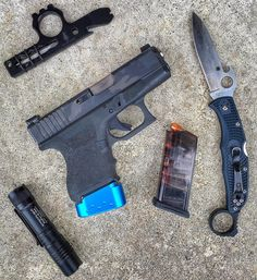 Glock 26 Gen 4 with a @barracuda_tactical mag extension Blacked Out Wise Guy available at @ic13arms @etsgroup 10 rd spare mag @streamlightinc Protac 1L-1AA @spyderco_inc Endura with our Signet Ring. 147g 9mm Speer Gold Dots #WiseMen #2a #edc #edcgear