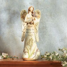 """Cherish Yesterday"" Angel with Cross - OrientalTrading.com"