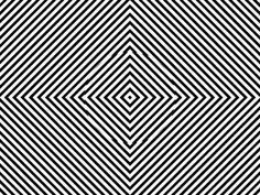 Look at the centre of the gif for about 30 secs and then look at the wall.