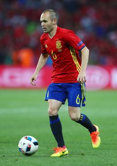 Andres Iniesta of Spain runs with the ball during the UEFA EURO 2016 Group D match between Spain and Turkey at Allianz Riviera Stadium on June 17, 2016 in Nice, France.
