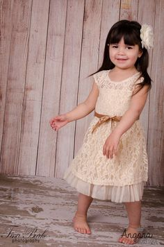 Our+Camille+beige+lace+dress+comes+with+a+pretty+satin+bow.+This+dress+would+be+perfect+for+a+fancy+outing,+also+for+a+flower+girl+dress.+Sizes+2T-5.+  +    Size+Chart:    2T:  Length:+18.90+inches  1/2+Bust:+9.06+inches    3T:  Length:+19.69+inches  Bust:+9.84+inches    4T:  Length:+20.47+inches...