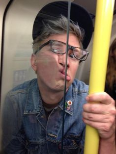 I don't know who Tyler Oakley is, but this photo of him smashing his face into a subway car divider and grasping onto that handle is making me wanna take an antibiotic gel shower. Effing GROSS!!