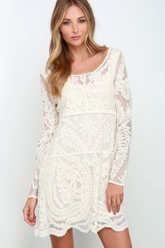 We can't take our eyes off the amazing Black Swan Heidi Cream Lace Long Sleeve Dress!