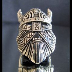 Hey, I found this really awesome Etsy listing at http://www.etsy.com/listing/128762769/thor-viking-ring-with-mask-horns