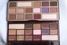 Too Faced Chocolate Bar eyeshadow palette vs Makeup Revolution I Heart Eye Shadow Palette in I Heart Chocolate. Too faced chocolate bar palette review and searches. Tam beauty makeup revolution I heart eye shadow palette review and swatches. Chocolate bar palette flat lay. Makeup flat lay. Chocolate bar eyeshadows review and swatches.