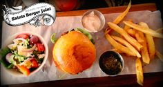 Saints Burger Joint in Big Bay at Eden on the Bay is a vibey and loud restaurant with amazing burgers and great live bands. Amazing Burger, Big Bay, My Recipes, Cantaloupe, Saints, Tea, Fruit, Travel, Food