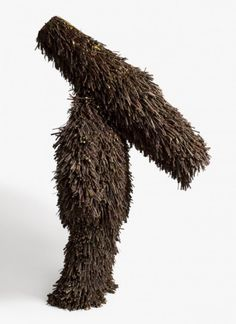 "Twigs, one of Nick Cave's first Sound Suits, he says they're ""full body suits constructed of materials that rattle with movement, like a coat of armor, (they) embellish the body while protecting the wearer from outside culture."" Cave constructed his first suit after watching the Rodney King incident"