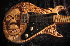 Ironside Ghostrider Guitar    Robert Ironside builds guitars which have been intricately carved to produce what are essentially works of art. Robert doesn't rely on paint to produce these stunning guitars, it's all done by hand with a chisel!
