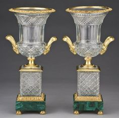 "PAIR OF RARE GILT BRONZE & MALACHITE URNS WITH RAMS HEADS. 18""H."