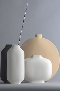 The KOSE range of ceramics are made from clay, wood and gauze and moulded into clean, tactile lines. Each piece is unique as they are all handcrafted using artisan techniques.  A a gorgeous, eclectic  work as individual pieces but really make an impact when grouped together, adding texture, colour and interest to a contemporary room.