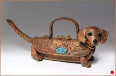Hot-Dig-It_Tea Dog is a ceramic teapot in the form of a Dachshund puppy.