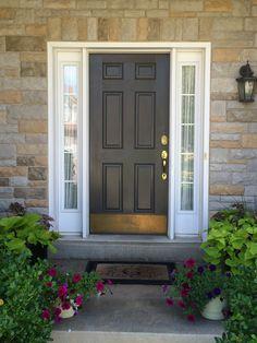 Front door and light painted Sherwin Williams Urbane Bronze.