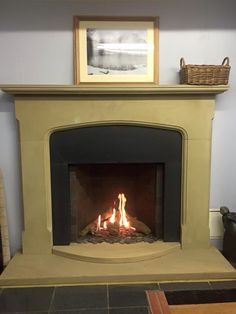 The Vento Classic Small Gas Fire from Bellfire with realistic wooden logs and anti reflective glass.