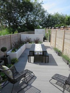 LONG NARROW CONTEMPORARY COURTYARD DESIGN, old fencing clad with Jacksons venetian panels, ecodeck pebble grey composite decking