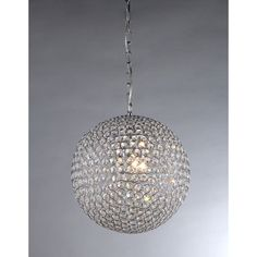 This round chrome chandelier will draw lots of compliments and will be the focal point of any room. The four-light fixture features multiple cascading crystals that make it sparkle, and it is constructed of metal to ensure its strength and durability.