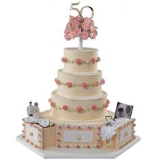 More Memories in Store! Cake - Celebrate their long-running love. Add photo panels and memento drawers to a luxuriously layered cake decorated with fondant and piped-icing flowers and orchid pink, white and gold Pearl Dust.
