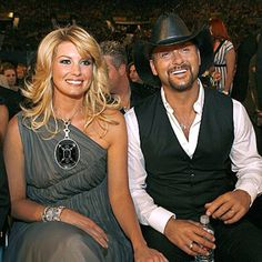 Faith Hill and Tim McGraw. And the person whom their heads are framing :)