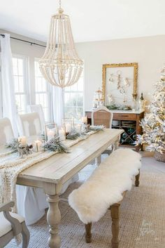 White Christmas Dining Room Shabby chic winter white Christmas dining room with flocked Christmas tree, glam decor, and metallic accents.Shabby chic winter white Christmas dining room with flocked Christmas tree, glam decor, and metallic accents. Shabby Chic Dining Room, Dining Room Table Decor, Dining Room Design, White Dining Table, White Dining Room Table, White Tables, Diningroom Decor, Dining Table Runners, Decor Room