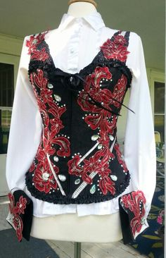 Stunning Western Pleasure show vest with MATCHING CUFFS! Since it is a corset, it fits many shaoes and sizes beautifully. Sizes 2-8. Swarofski crystals and pearls set off this elegant outfit. For sale $900.