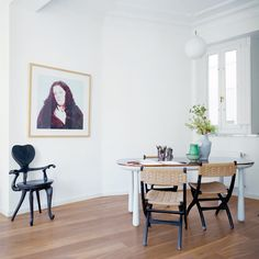 """The best way to integrate different furniture styles is to treat """"the space like a gallery and place objects according to their colors,"""" Hayon says. He cautions against using too much natural wood furniture in a space with wood floors: """"You need contrast."""" In his home, contrasting materials, small porcelain objects, and an occasional black form enliven a palette of light gray furniture."""
