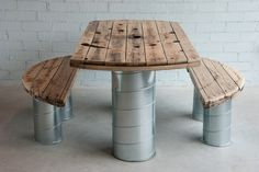 Table and benches made with the top of a wooden spool of electrical cable and helicoidal galvanized steel ducts.