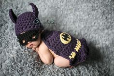 The original batgirl.  Newborn baby girl in batgirl costume by Prairie Tots Boutique.  Sunny S-H Photography.