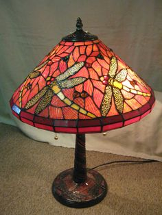 """A great antique looking lamp perfect for adding a little bit of sophisticated whimsy to your home. The lamp measures 23"""" T and 18"""" W."""