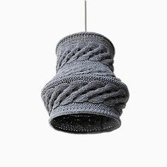 I have thought for a long time about designing knitted lampshades.  This is too dense to me but love the shape!