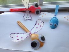 simple dragonflies - could be laid around on windowsills or attached to the walls.  Pretty sure there are googly eyes in the craft closet already