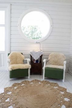 Living room. Love the green chairs and the brown rug.
