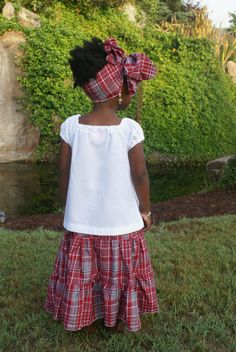 Traditional Jamaican bandana skirt and blouse outfit. The white shirt with…