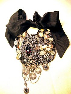 Amazing necklace made from old jewelry! I came across this DYI project by Sabii Wabii online...she has inspired me to dig out and reinvent the bottom of my jewelry box.